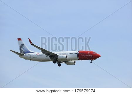 Amsterdam the Netherlands - March 31st 2017: LN-NGN Norwegian Air Shuttle Boeing 737 approaching Polderbaan runway at Schiphol Amsterdam Airport the Netherlands