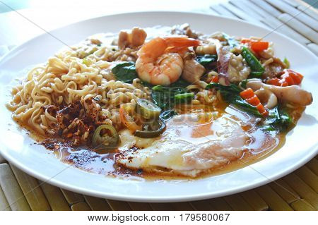 instant noodle dressing seafood gravy sauce and creamy egg yolk on dish