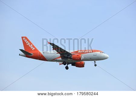 Amsterdam the Netherlands - March 31st 2017: G-EZDE easyJet Airbus A319-111 approaching Polderbaan runway at Schiphol Amsterdam Airport the Netherlands
