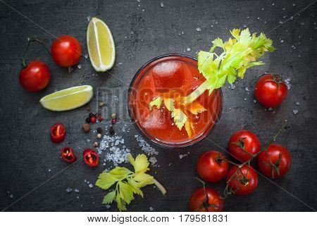 Bloody Mary cocktail. Alcoholic drink and ingredients at dark slate table. Top view