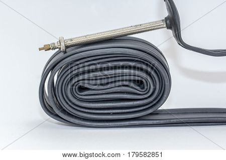 Bicycle tube with 80mm presta valve,removable valve core with 86 grams isolated on a white background.Bicycle tools.