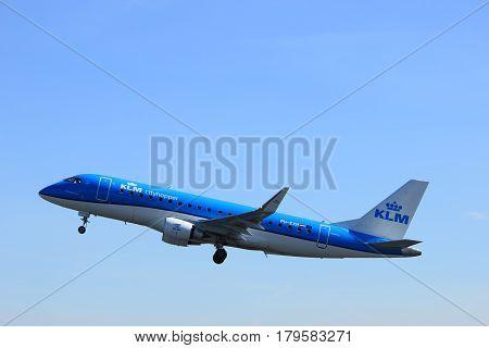 Amsterdam the Netherlands - March 25th 2017: PH-EXB KLM Cityhopper Embraer ERJ-190 takeoff from Polderbaan runway.
