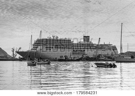 Victoria Mahe Island Seychelles - December 152015: Costa Neoromantica Cruise ship anchored at Victoria port Mahe Island Seychelles. Black and white photography.