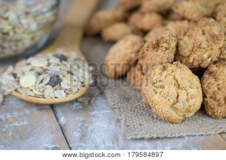 Homemade biscuits and granola on a rustic wooden table. The concept of natural dietary health products.