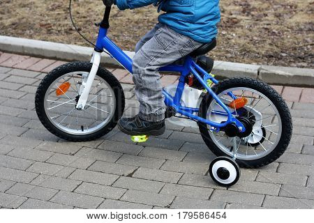 Children's sports entertainment. The image of a child who is riding a children's Bicycle.