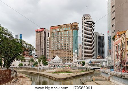 Kuala Lumpur, Malaysia - February 7, 2016: Cityscape with modern and old traditional building and Masjid Jamek Mosque in Kuala Lumpur, Malaysia.