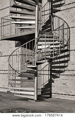 Black and white shot of a winding staircase