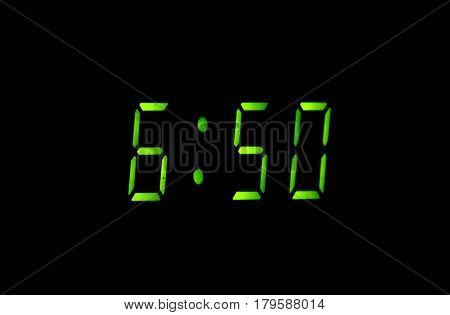 Greater green figures of digital watchs on a black background