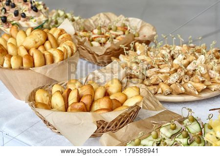 Catering of snacks canapes and patties on table