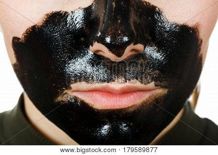 Close up photo of young woman with facial black mask