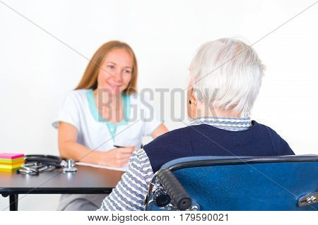 Photo of elderly women with the young doctor