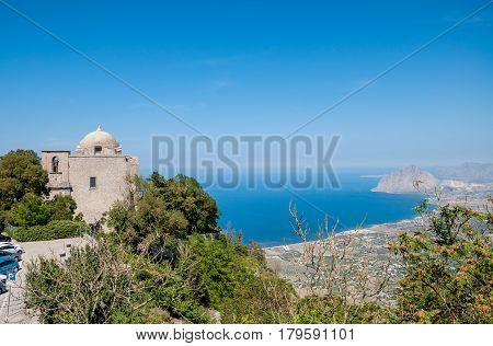 ERICE ITALY - SEPTEMBER 12 2015: The Church of St. John the Baptist and Cofano mount in Erice province of Trapani in Sicily Italy