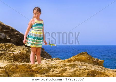 Girl Stands On Top Of Cliff. Bali, Crete