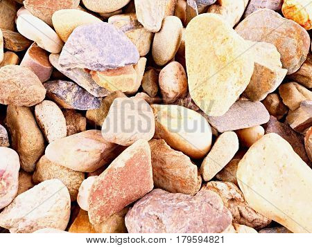 Old Stony Pavement From Natural Gravel, Dry Rounded And Colorful Pebbles.