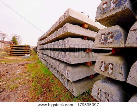 Sleepers Stock In Railway Depot. New Concrete Railway Ties Stored For Reconstruction Of Old Railway