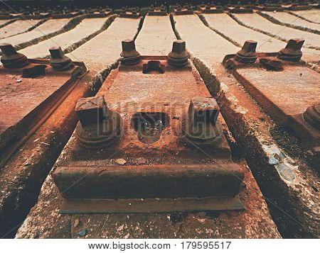 Used Sleepers Stock In Railway Depot. Old, Dirty And Rusty Used Concrete Railway Ties Stored