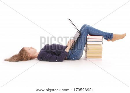 Student teenage girl lying sideways on the floor with laptop isolated on white