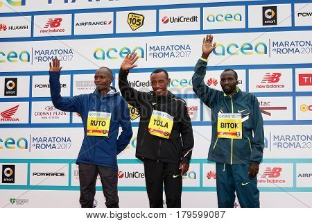 Rome Italy - April 2 2017: On stage with the top three finishers in the men's race of the 23rd marathon in Rome. At the center of Tola Shura Kitata first place. To his right Dominic Ruto Kipngetich second place. To his left Bitok Benjamin Kipngetic third