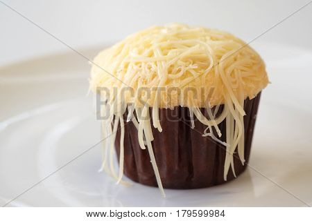 Souffle cup cheesecake on white plate and background..