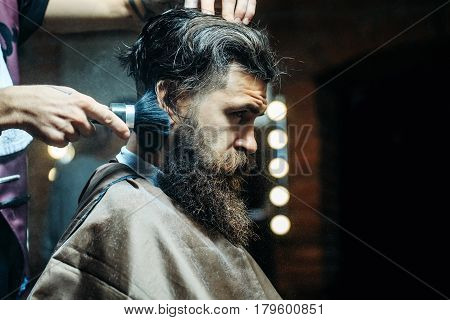 Bearded Man Getting Powder On Skin With Makeup Brush