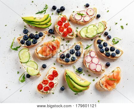 Homemade summer toast with cream cheese Smoked Salmon, Blueberries, Radish, Cucumber, Avocado and cress salad. Fresh healthy concept food