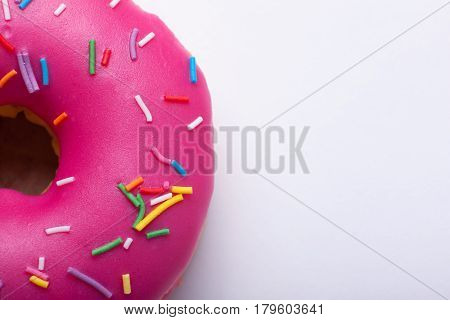 Raspberry Donut With Icing On A White Background. Top View With Copy Space