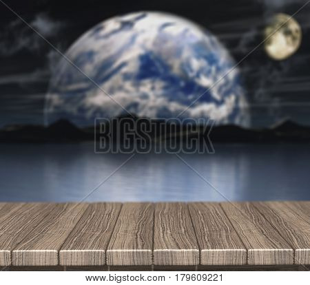 3D render of a wooden table looking out to a defocussed night scene with fictional planets