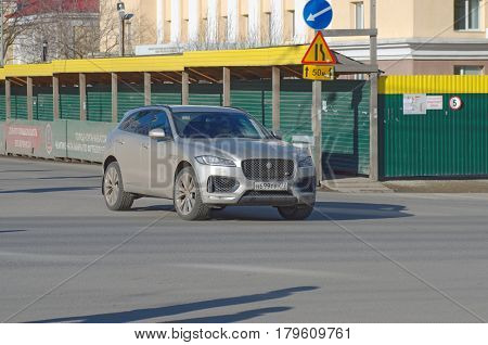 Saransk, Russia - March 26, 2017: Jaguar F-PACE turning to the left on crossroads.