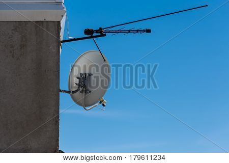 Satellite and terrestrial antennas fixed to wall