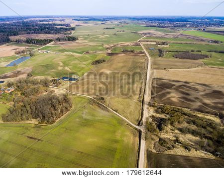 Drone Image. Aerial View Of Rural Area With Freshly Green Fields