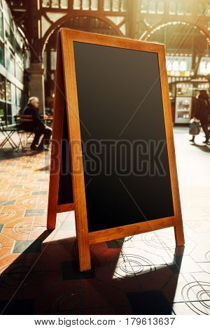 Empty restaurant menu street black chalkboard as copy space unrecognizable people in the background