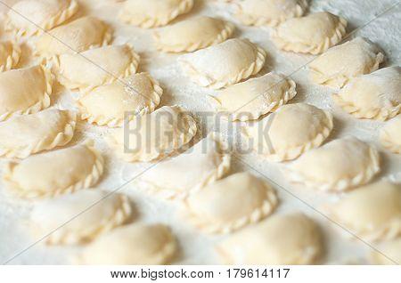Vareniki (dumplings) With Potatoes On White Background - Traditional Ukrainian Food. Cooking Raw Dum