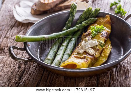 Asparagus and omelette.Omelette stuffed with asparagus and cheese for a breakfast.
