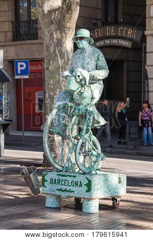 BARCELONA SPAIN - OCTOBER 23 2015: La Rambla is a pedestrian street in central Barcelona popular with tourists and locals alike Spain
