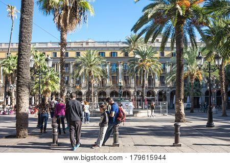 BARCELONA SPAIN - OCTOBER 23 2015: The Plaza Real is one of the most famous squares of the city Barcelona Spain. It is located in the Gothic Quarter and it is famous for its arcades that surround the square