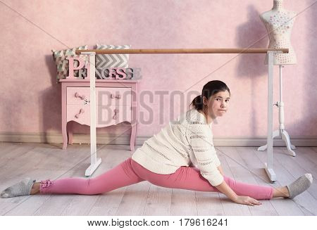 Teenager Girl In Ballet Class Hall Exercise Split