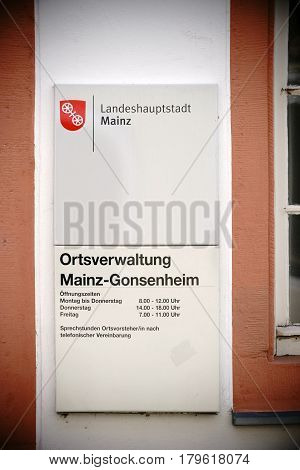 MAINZ, GERMANY - MARCH 22: The entrance sign of the city administration in Mainz Gonsenheim with the opening hours on March 22 2017 in Mainz.