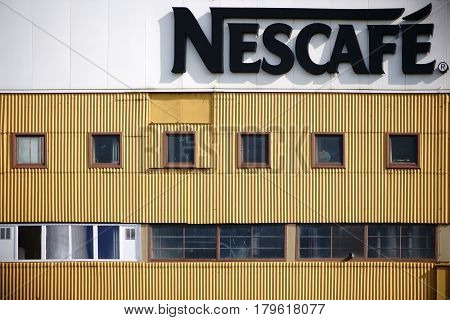 MAINZ, GERMANY - MARCH 24: The facade of the industrial building of the beverage and coffee maker Nescafe with logo on March 24 2017 in Mainz.