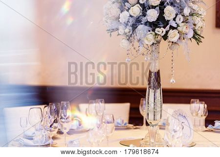 Luxury Wedding Decor With Flowers And Glass Vases And Number  Of Setting On Round Tables. Arrangemen
