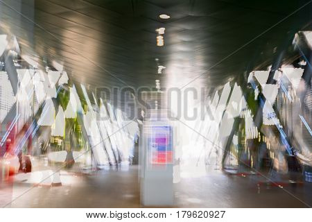 Modern architecture, Train station with escalators, supportive metal beams, tickets machine. Multiple exposure image. London. UK