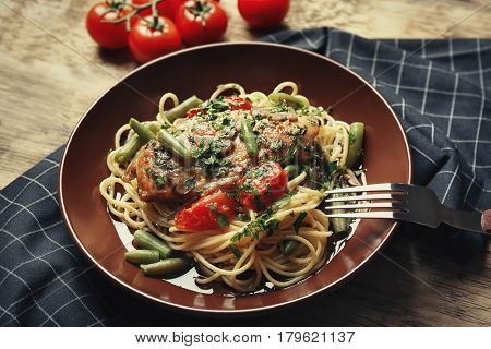 Delicious chicken marsala with spaghetti on plate