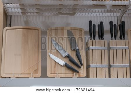 Set of knives on a wooden board
