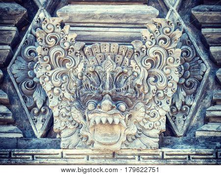 Stone sculpture on entrance door of Pura Padmasana Puja Mandala temple