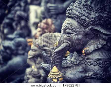 Ancient Balinese statue at the temple in Bali Indonesia