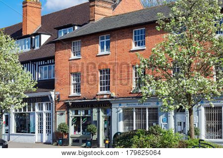 Hartley Wintney, UK. 2nd April 2017. Springtime on a Sunday afternoon in Hartley Wintney high street. Shops and retail establishments are open.