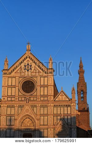 Santa Croce church Florence marble facade over light blue sky background.