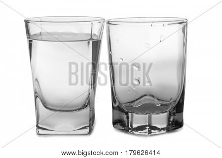 Vodka in a glass and decanter on a white background