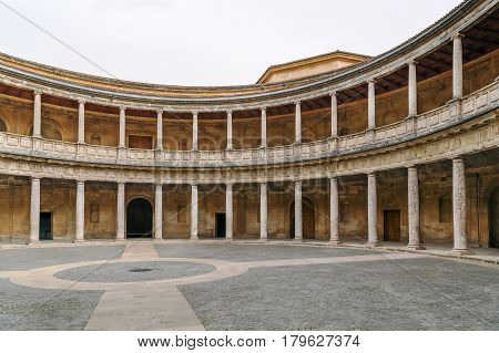 Palace of Charles V is a Renaissance building in Granada located on the top of the hill of the Assabica inside the Nasrid fortification of the Alhambra. Patio