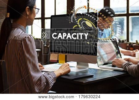 Capacity word graphic design with people working in the office