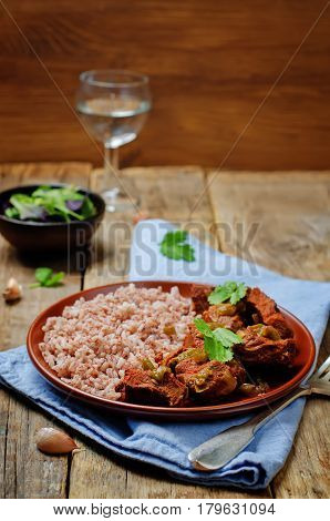 Healthy dish. Beef slow cooker with red and white rice and greens.